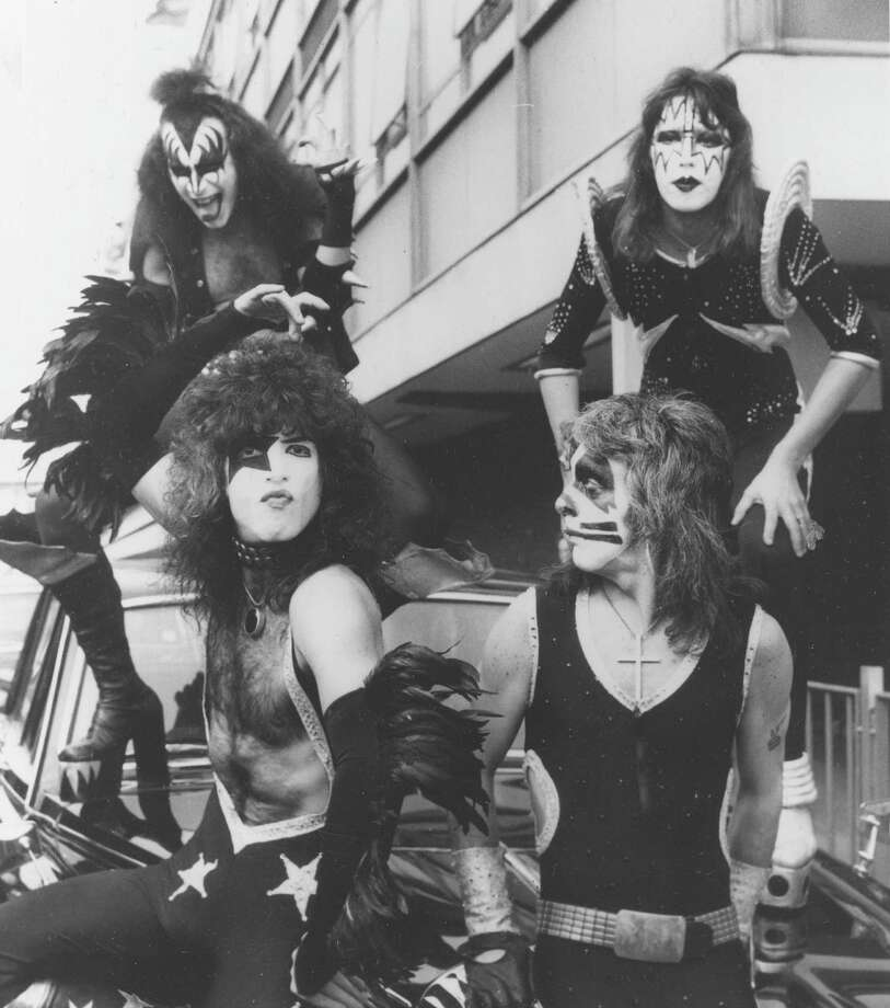 American rock and roll legend KISS arrives at Heathrow Airport in London, on May 12, 1976, for their concert tour through Great Britain. In the back are bassist Gene Simmons, left, and guitarist Ace Frehley; in front are singer/guitarist Paul Stanley and drummer Peter Criss. Photo: AP / 1976 AP