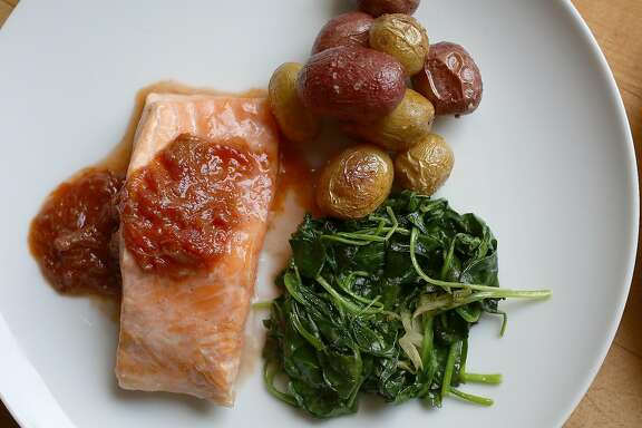 "Joyce Goldstein made salmon with tomato rhubarb sauce at her home in San Francisco, California on thursday, march 7, 2016.  Joyce Goldstein has a new book ""The New Mediterranean Jewish Table""."
