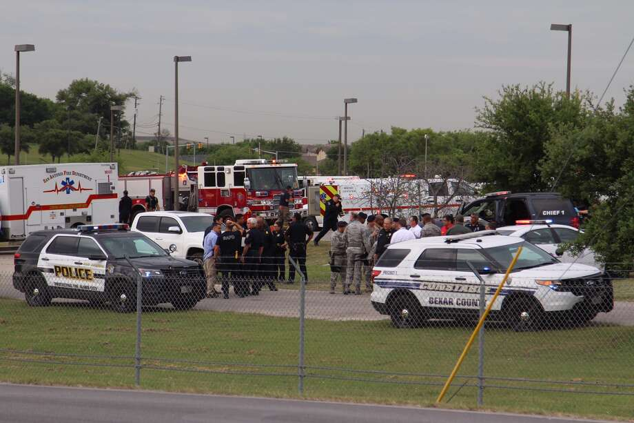 Emergency personnel respond to an active shooting at Lackland Air Force Base Friday, April 8, 2016. Photo: By Tyler White, San Antonio Express-News