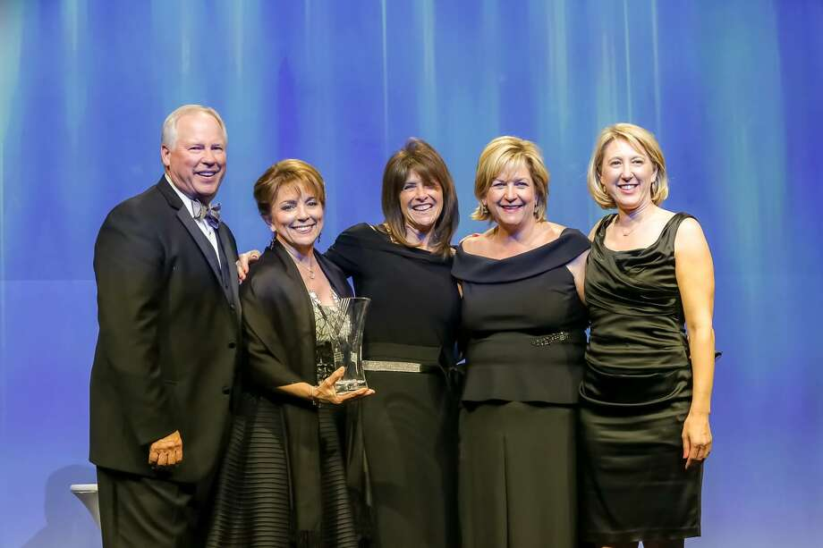 At the conference were (left to right) Pat Riley, chairman of the board, Leading Real Estate Companies of the World; Robin Mueck, chairman and CEO, Heritage Texas Properties; Gina Schoener, relocation manager, Heritage Texas; Chaille Ralph, president, Heritage Texas; and Kirsten Abney, senior vice president, Heritage Texas.