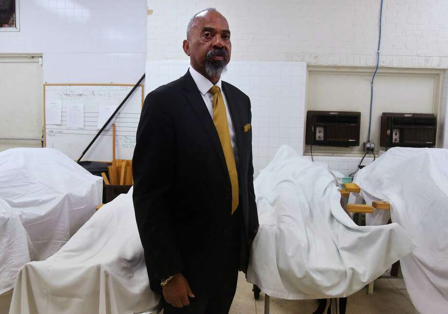 James Bryant, chief embalmer at Lewis Funeral Home, has been selected as Embalmer of the Year by the National Office of Epsilon Nu Delta Mortuary Fraternity. He is a Vietnam veteran. Photo: Billy Calzada, Staff / San Antonio Express-News / San Antonio Express-News