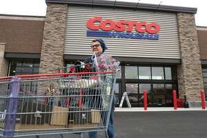 FILE - In this Nov. 12, 2014 file photo, Linda Bultema leaves the Costco store in Kalamazoo, Mich. Costco on Monday, March 2, 2015 said it struck a deal for Citi to be the exclusive issuer of its co-branded credit cards, with Visa replacing American Express as the card network. (AP Photo/Kalamazoo Gazette - MLive Media Group, Mark Bugnaski, File) ALL LOCAL TELEVISION OUT; LOCAL TELEVISION INTERNET OUT