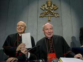 """Cardinals Lorenzo Baldisseri, left, and Christoph Schoenborn show a copy of the post-synodal apostolic exhortation ' Amoris Laetitia ' (The Joy of Love) during a press conference at the Vatican, Friday, April 8, 2016. Pope Francis has insisted that individual conscience be the guiding principle for Catholics negotiating the complexities of sex, marriage and family life in a major document released Friday that repudiates the centrality of black and white rules for the faithful. In the 256-page document """"The Joy of Love,"""" released Friday, Francis makes no change in church doctrine. (AP Photo/Andrew Medichini)"""