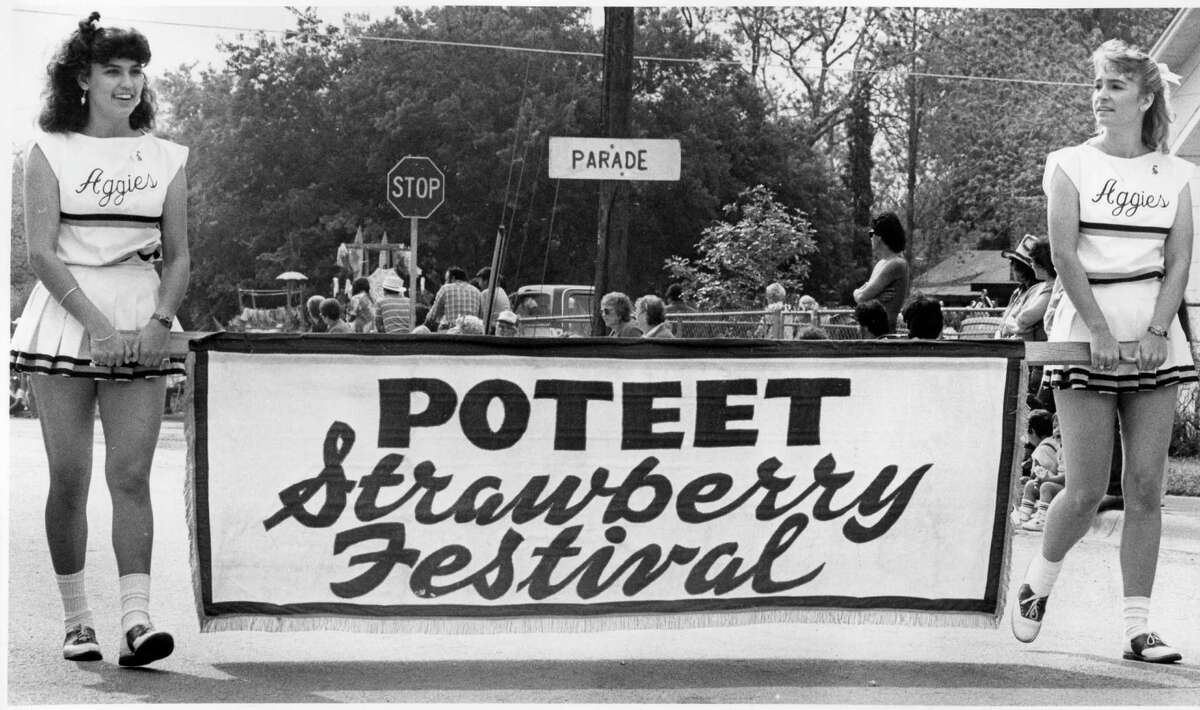 Aggie cheerleaders lead the Poteet Strawberry Festival parade in 1987.