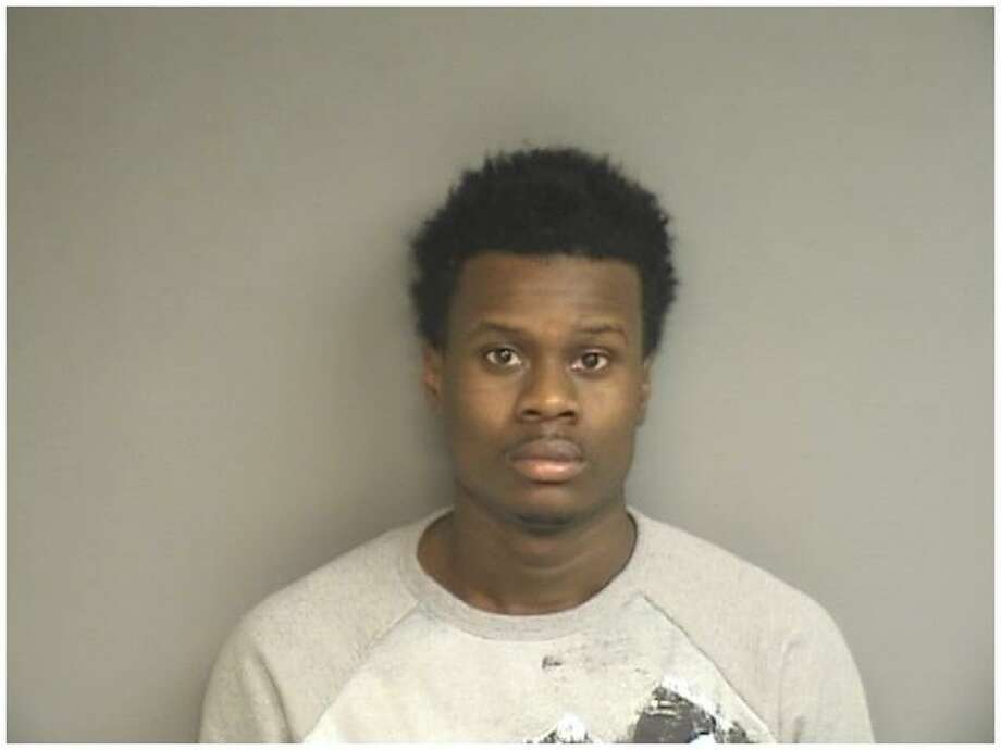 Che McCoy, 24, of Stamford, was charged with larceny, forgery, credit card theft by transfer and identity theft after police searched his car and allegedly found a virtual check forgery shop. Photo: Stamford Police / Contributed