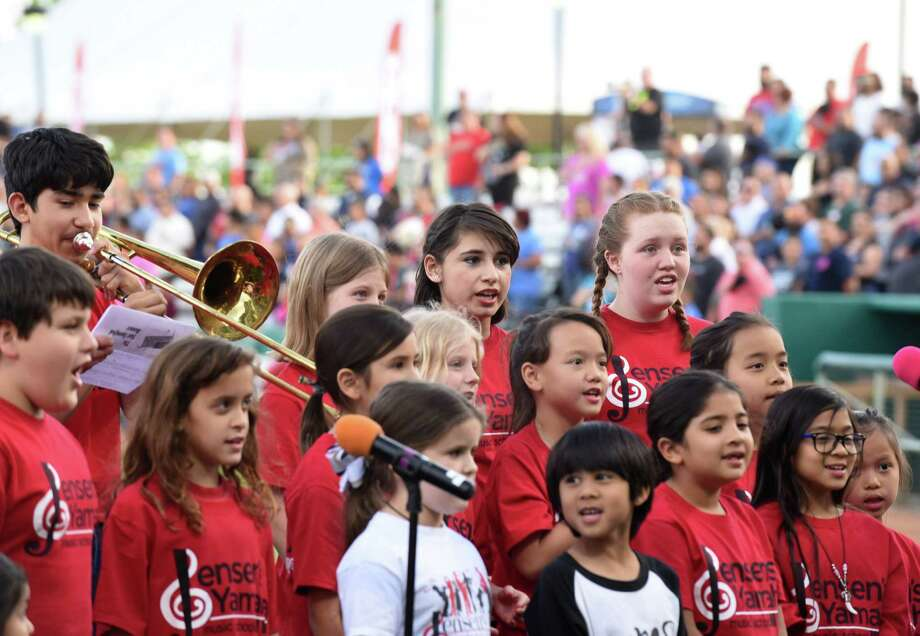 Children of Jensen's Yamaha Music School perform the Star Spangled Banner prior to the Springfield Cardinals at San Antonio Missions Texas League baseball game at Nelson Wolff Stadium on Thursday, April 7, 2016. Photo: Billy Calzada, Staff / San Antonio Express-News / San Antonio Express-News