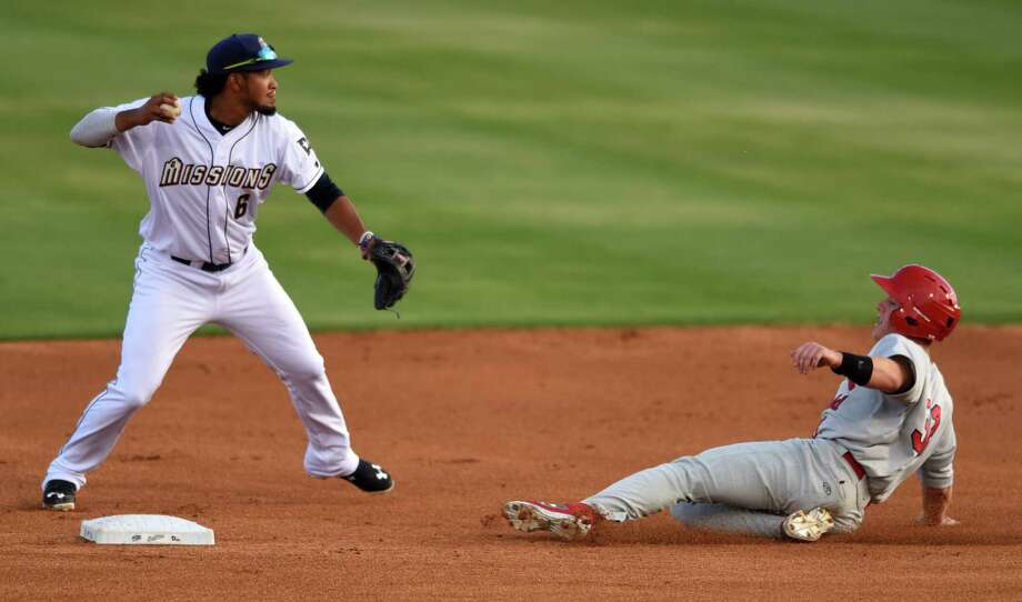 The Missions' Jose Rondon turns a double play as Harrison Bader of Springfield slides at second base during Texas League action at Wolff Stadium on April 7, 2016. Photo: Billy Calzada /San Antonio Express-News / San Antonio Express-News