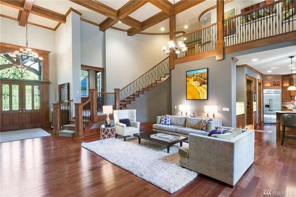 Its entry features a boxed-beam ceiling and floors made of merbau wood.