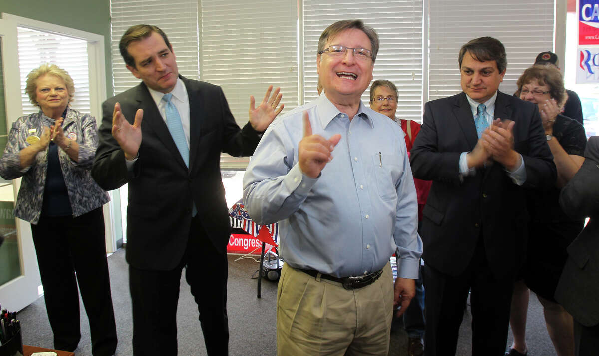"""Republican Senate candidate Ted Cruz (left) visits with Representative Francisco """"Quico"""" Canseco, (center) R-San Antonio, during a small rally of supporters Thursday October 25, 2012 at an office on the 10,000 block of Bandera Road. On the right clapping is Steve Munisteri, Chairman of the Republican Party of Texas."""