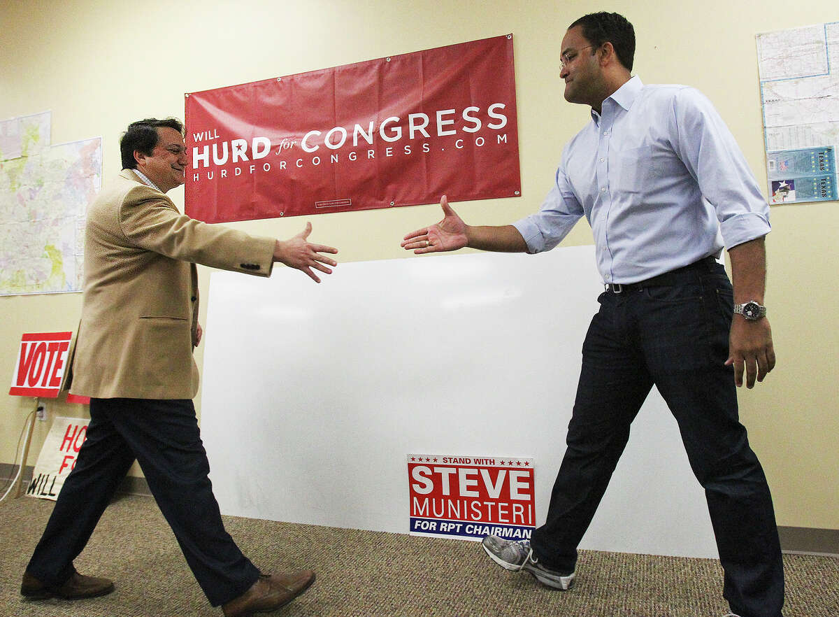 Congressional candidate Will Hurd greets Steve Munisterie, Chairman of the Texas GOP, as he gathers his supporters at his Huebner Rd campaign office for a door to door campaign effort on November 1, 2014.
