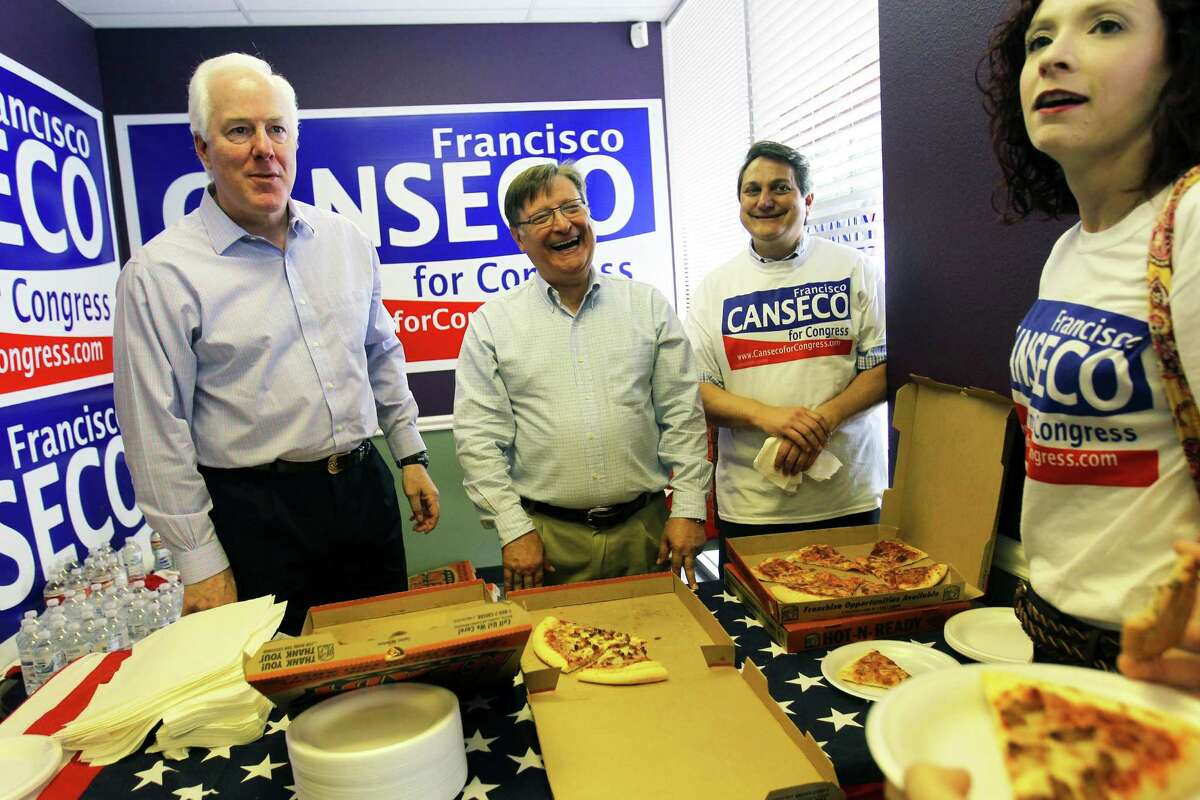 """United States Senator John Cornyn, left, Canseco, and Republican Party of Texas Chairman Steve Munisteri hand out pizza to volunteers and supporters during a campaign event at Francisco """"Quico"""" Canseco's north west side campaign office, Saturday, October 20, 2012. Canseco (R-SA) is running hard against state Rep. Pete Gallego, (D-Alpine), in the race for U.S. House District 23. (JENNIFER WHITNEY)"""