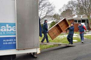 Professional movers from Mabey's Moving and Storage load the contents of a home into their moving van Wednesday April 6, 2016 in Troy,NY.  (John Carl D'Annibale / Times Union)