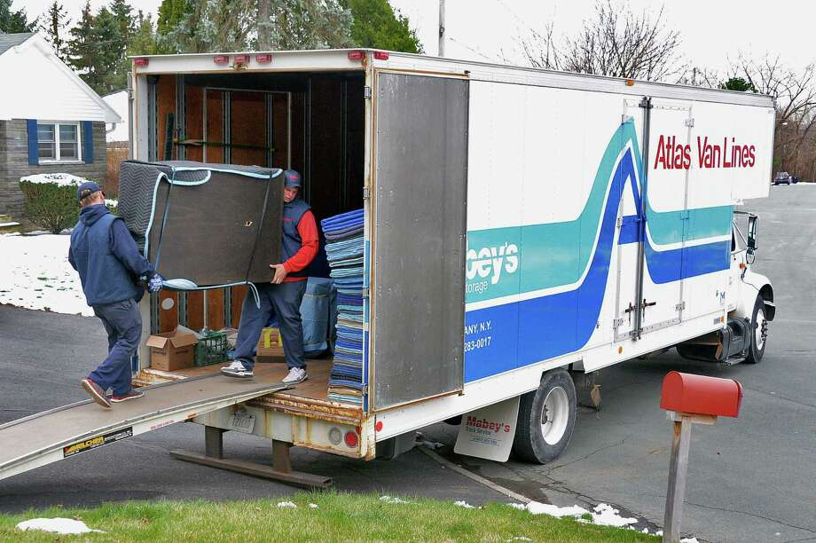 Professional Movers Dylan White, Left, And Tom Gill Of Mabeyu0027s Moving And  Storage Load