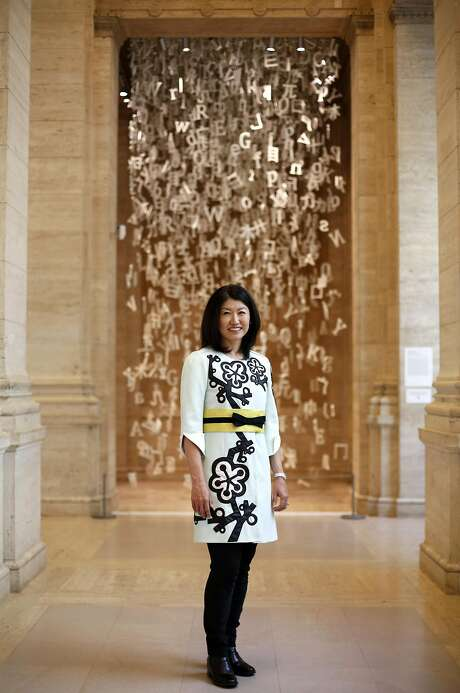 "Akiko Yamazaki, chairwoman of the foundation of the Asian Art Museum, with the piece ""Collected Letters."" Photo: Connor Radnovich, The Chronicle"