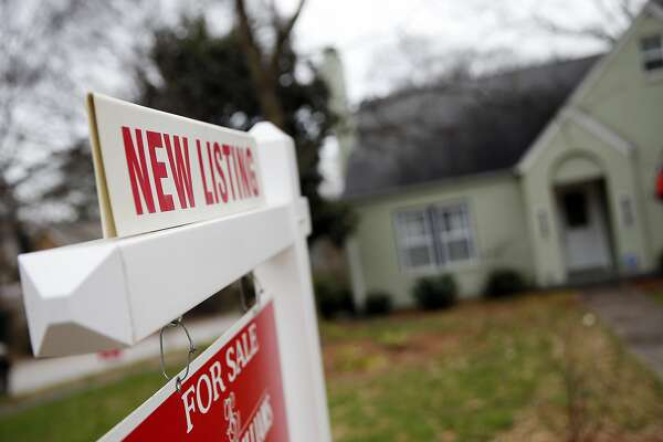 "In this Tuesday, Jan. 26, 2016, photo, a ""For Sale"" sign hangs in front of an existing home in Atlanta. On Wednesday, Feb. 24, 2016, the Commerce Department reports U.S. home sales crept upward in January, a sign that demand for housing remains strong amid signs of slower growth across the broader economy. (AP Photo/John Bazemore)"