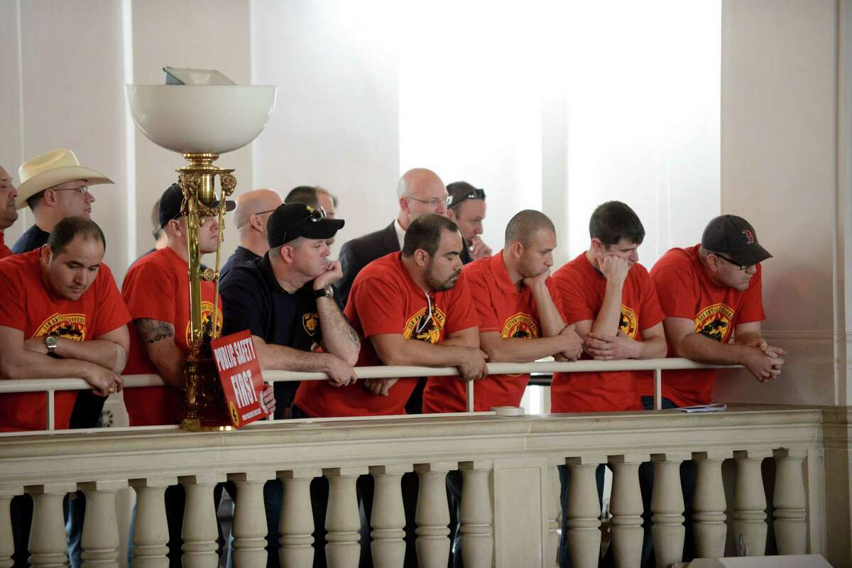 In this file photo, police and firefighters union members listen as city council prepares to hears the recommendations of a task force considering their retirement and health benefits. The firefighters union is pushing against City Council on other issues.
