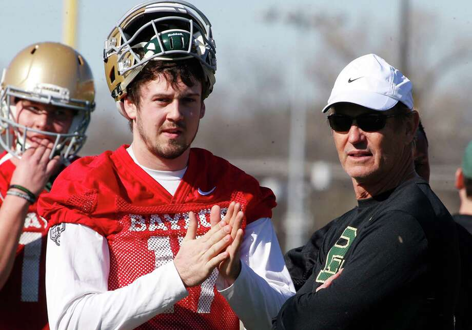 Baylor quarterback Seth Russell looks on with head coach Art Briles during the first day of spring drills on Feb. 25, 2016, in Waco. Photo: Rod Aydelotte /Waco Tribune-Herald / Waco Tribune Herald