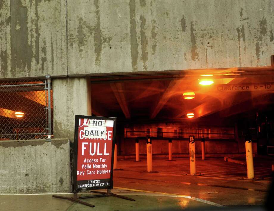 "This file photo shows a ""full"" sign at the public parking garage at the Stamford train station. The state spent $1.7 million to offset commuters' cost to park in private lots while the garage was under repair. Photo: File Photo / Stamford Advocate"