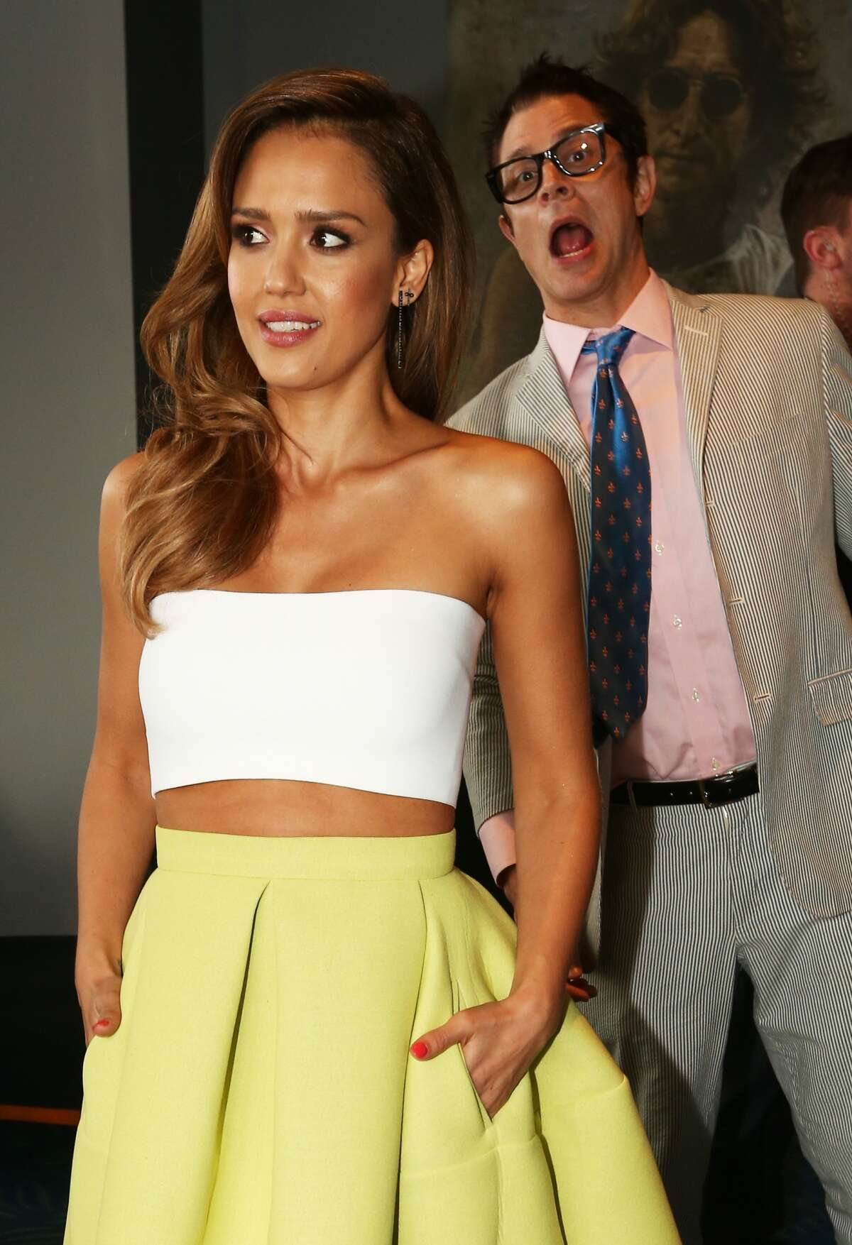 Actor Johnny Knoxville (R) photobombs actress Jessica Alba at the 2014 MTV Movie Awards at Nokia Theatre L.A. Live on April 13, 2014 in Los Angeles, California. KEEP CLICKING FOR SOME OF HOLLYWOOD'S FUNNIEST OFFENDERS.