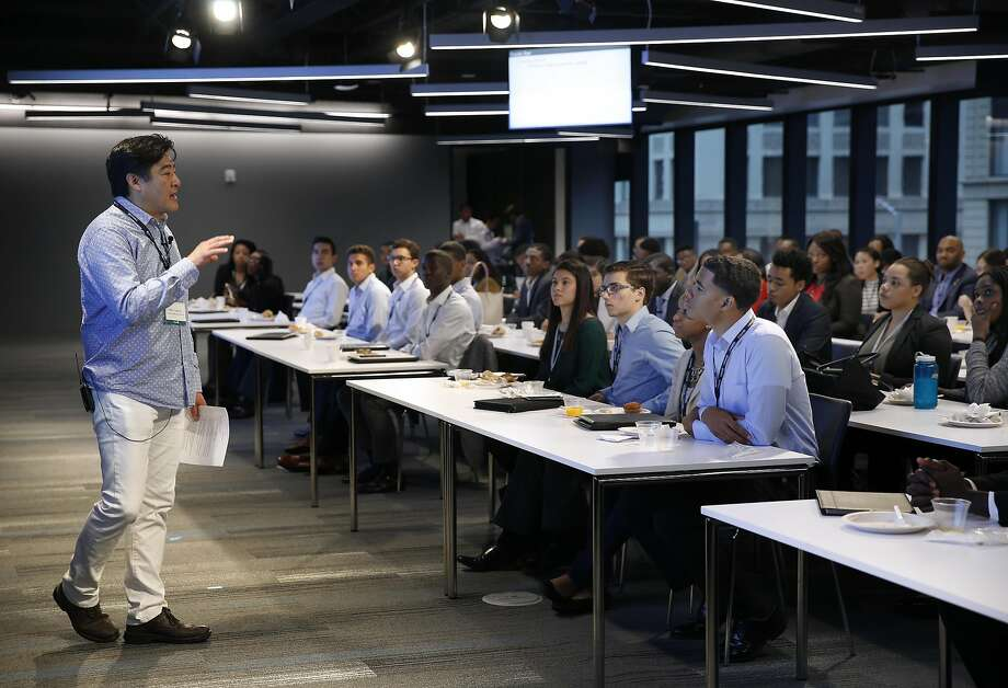 Mark Taguchi leads a discussion at the tech boot camp hosted by LinkedIn. Three hundred college juniors participated in the intern preparation program in S.F. Photo: Paul Chinn, The Chronicle