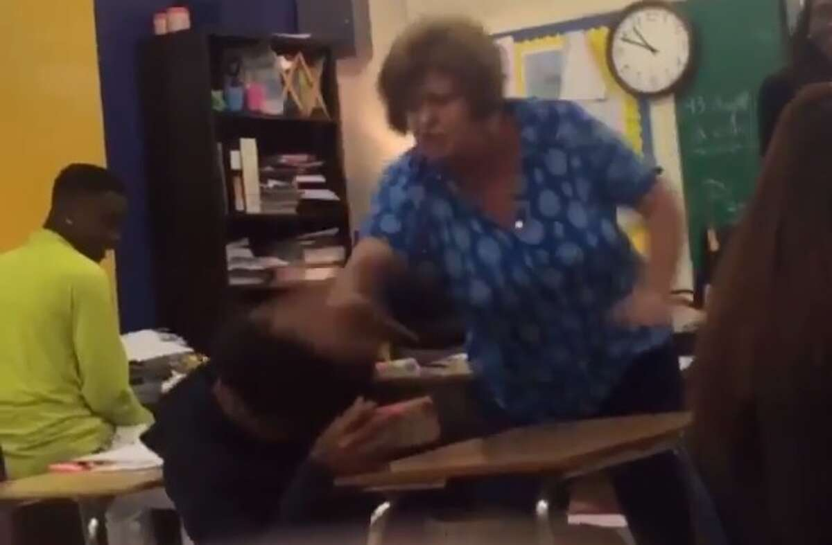 A video shared on Twitter on April 8 shows a teacher at Ozen High School hitting a student repeatedly and shouting at him. Screenshot via Twitter