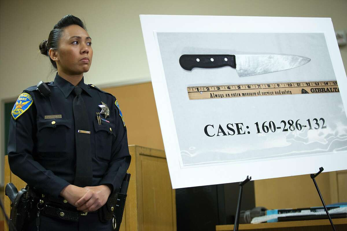 San Francisco police spokeswoman Grace Gatpandan stands attentively at the Hall of Justice, Friday, April 8, 2016 in San Francisco. Police held a news conference to update members of the media about the fatal police shooting of Luis Gongora, a homeless man who was reported to have charged at police officers with a kitchen knife on April 7.