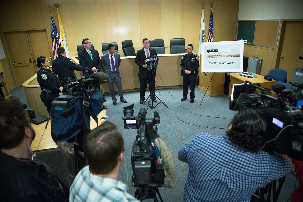 Commander Greg McEachern, center, who oversees the SFPD Investigations Division, speaks to members of the media during a news conference at the Hall of Justice, Friday, April 8, 2016 in San Francisco. McEachern updated the media about the fatal police shooting of Luis Gongora, a homeless man who was reported to have charged at police officers with a kitchen knife on April 7.