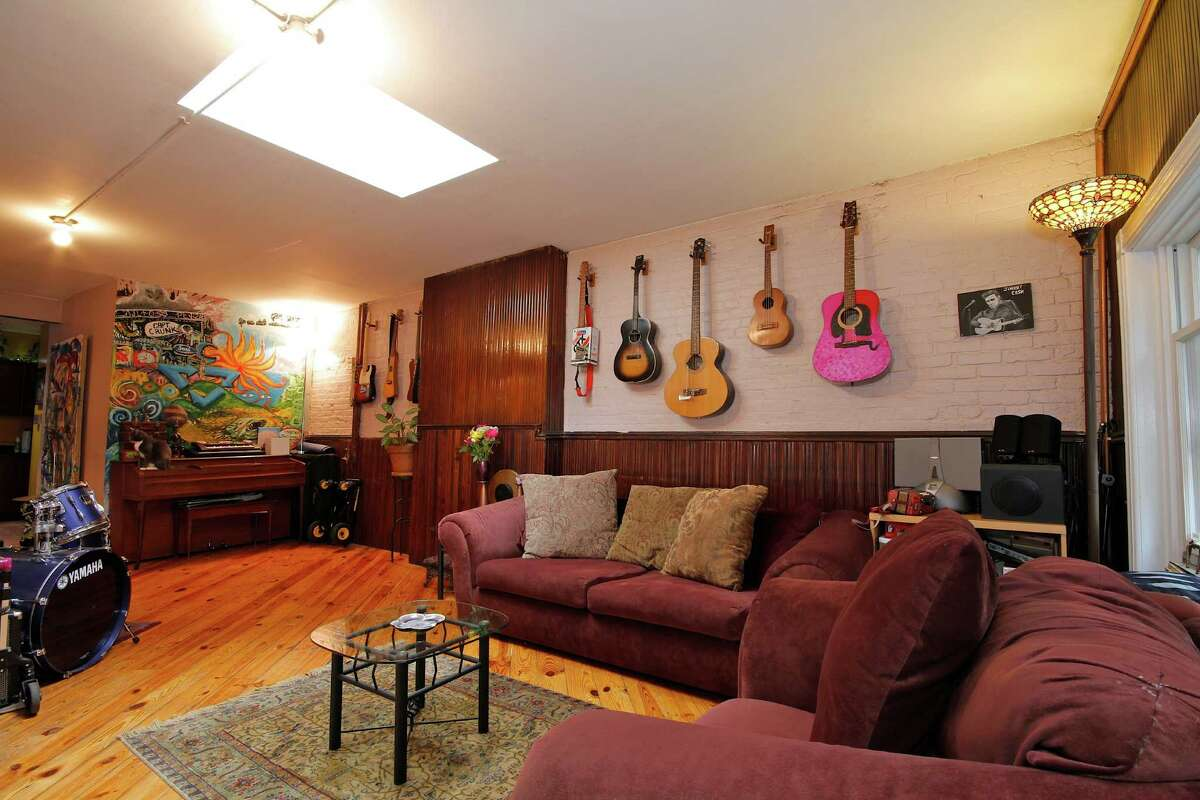 This historic New York rental, called the Treehouse, sits in a building full of artists, and features a collection of guitars in the Financial District in Lower Manhattan. The area was famously home to two iconic punk venues in the 1970s: Max's Kansas City, and CBGB on the Bowery.