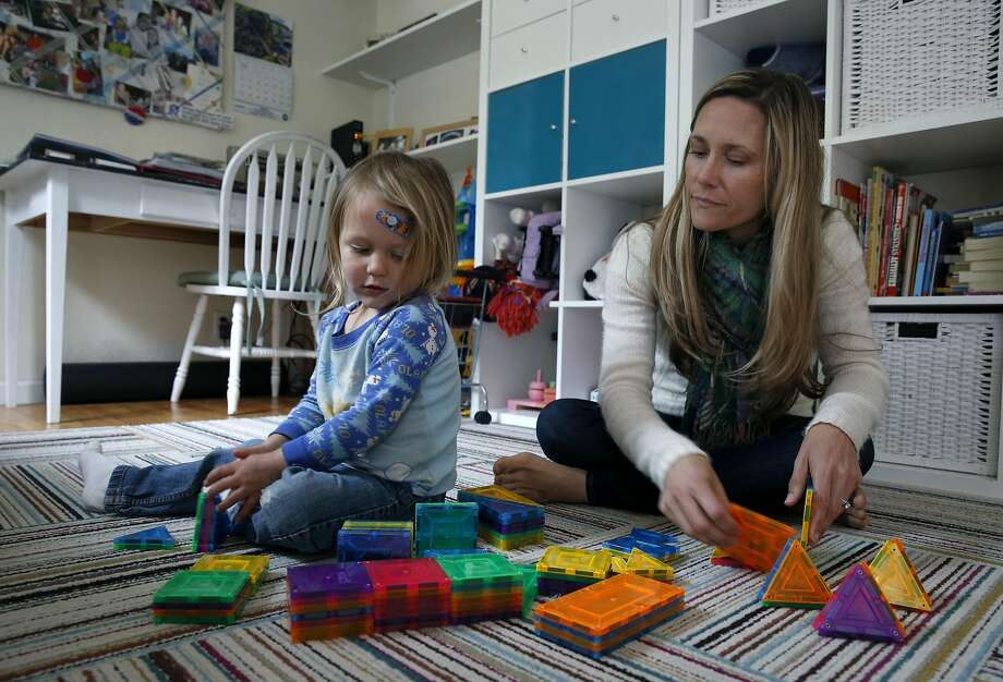 Caitlin King plays with her two-year-old son at their home in Pacifica. King heads the California chapter of Moms Demand Action, an anti-gun-violence grassroots organization. Photo: Paul Chinn, The Chronicle