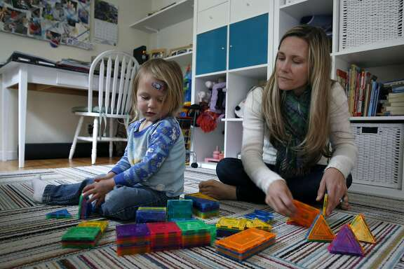 Caitlin King plays with her two-year-old son at their home in Pacifica, Calif. on Friday, April 8, 2016. King heads the California chapter of Moms Demand Action, an anti-gun violence grassroots organization.