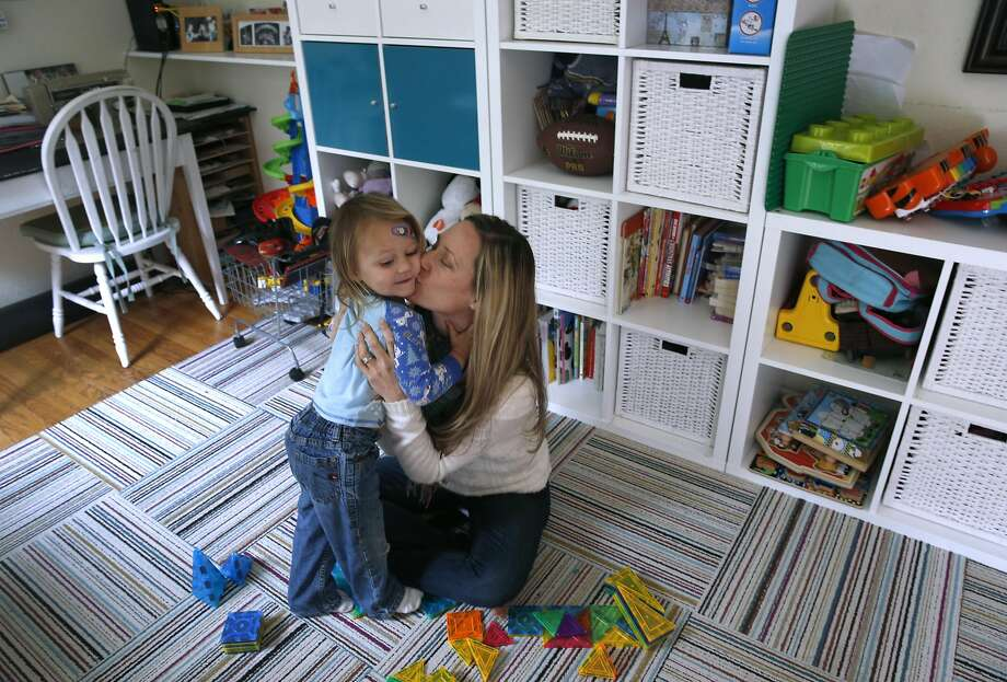 Caitlin King, who heads the California chapter of Moms Demand Action for Gun Sense in America, plays with her son. Photo: Paul Chinn, The Chronicle
