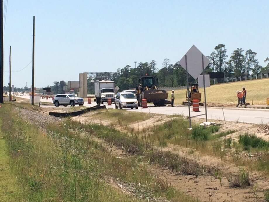 Construction crews work on final touches along Riley Fuzzel Road, next the newly-opened Grand Parkway. Area residents have complained of severe traffic headaches surrounding construction of the parkway, which connects Interstate 45, near The Woodlands, to U.S. 59, near Kingwood.