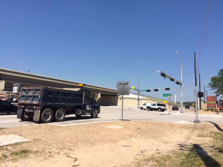 Construction vehicles linger at the intersection of the newly-opened Grand Parkway and Rayford Road in Spring. Area residents have endured paralyzing traffic surrounding construction of the parkway, which connects Interstate 45, near The Woodlands, to U.S. 59, near Kingwood.