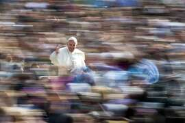 Pope Francis waves to the crowd as he arrives on his pope-mobile for his weekly general audience, in St. Peter's Square at the Vatican, Wednesday, April 6, 2016. (AP Photo/Andrew Medichini)