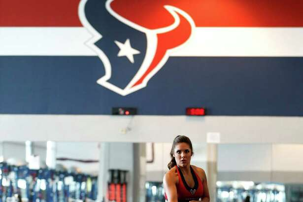 Madison, a Houston Texans cheerleader works out by pulling a weighted sled in the Houston Texans weight room,  Wednesday, April 6, 2016, in Houston.
