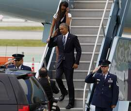 President Obama and his daughter Malia leave Air Force One after arriving at San Francisco International Airport in San Francisco, Calif., on Friday April 8, 2016