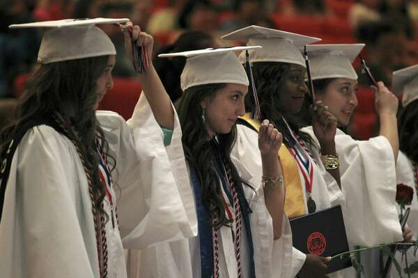 The top 10 percent rule is supposed to guarantee that high performing students in Texas public high schools automatically are eligible for admission to Texas public universities. Some, however, want to change the rules for the University of Texas's flagship school in Austin. From left, Evelyn Ibarra, Gabriela Lara and Thristian Lewis move their tassels during the Young Women's Leadership Academy commencement ceremony in 2014, at Laurie Auditorium on the Trinity University campus in San Antonio. The academy is an all girl's school in San Antonio Independent School District.