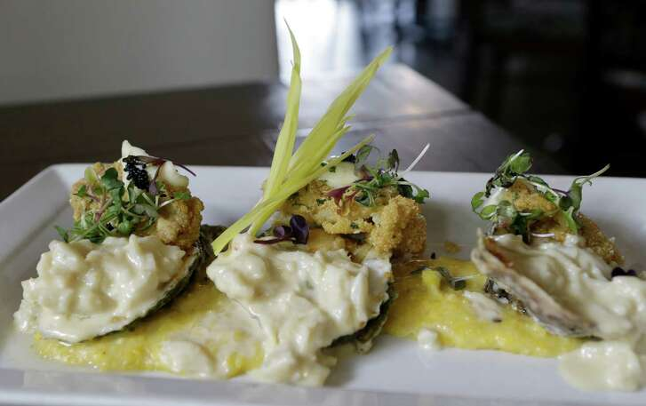 Oyster Virginia is shown at Corner Table,2736 Virginia St., Thursday, March 3a, 2016, in Houston. Eric Aldis is the chef. ( Melissa Phillip / Houston Chronicle )