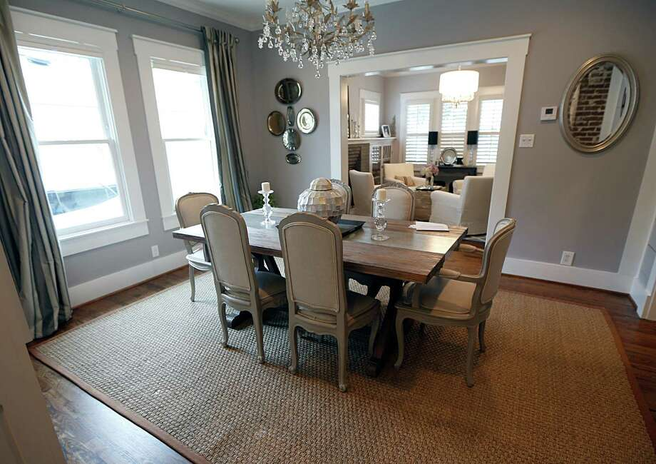 The Browns' dining room is a mostly open space between the formal living room and the new kitchen. Photo: James Nielsen, Staff / © 2016  Houston Chronicle