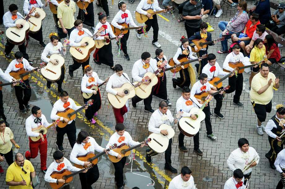 The San Antonio ISD Mariachi students play music as they march during San Antonio Fiesta's Battle of Flowers parade on Friday, April 24, 2015 through downtown San Antonio. Photo: Matthew Busch, For The San Antonio Express-News / © Matthew Busch