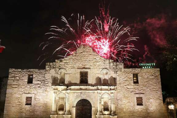 Fireworks explode behind the Alamo during the official opening of Fiesta in 2015.