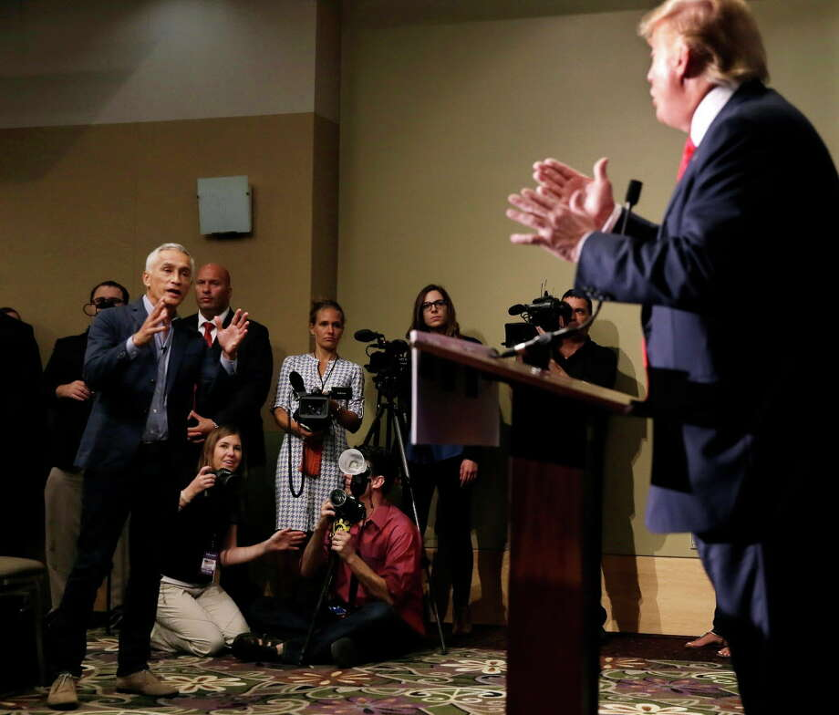 Miami-based Univision anchor Jorge Ramos, left, asks Republican presidential candidate Donald Trump a question about his immigration proposal during a news conference. Photo: Charlie Neibergall, STF / AP