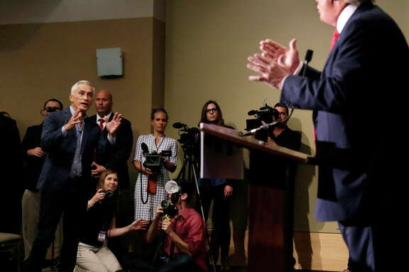 Miami-based Univision anchor Jorge Ramos, left, asks Republican presidential candidate Donald Trump a question about his immigration proposal during a news conference.
