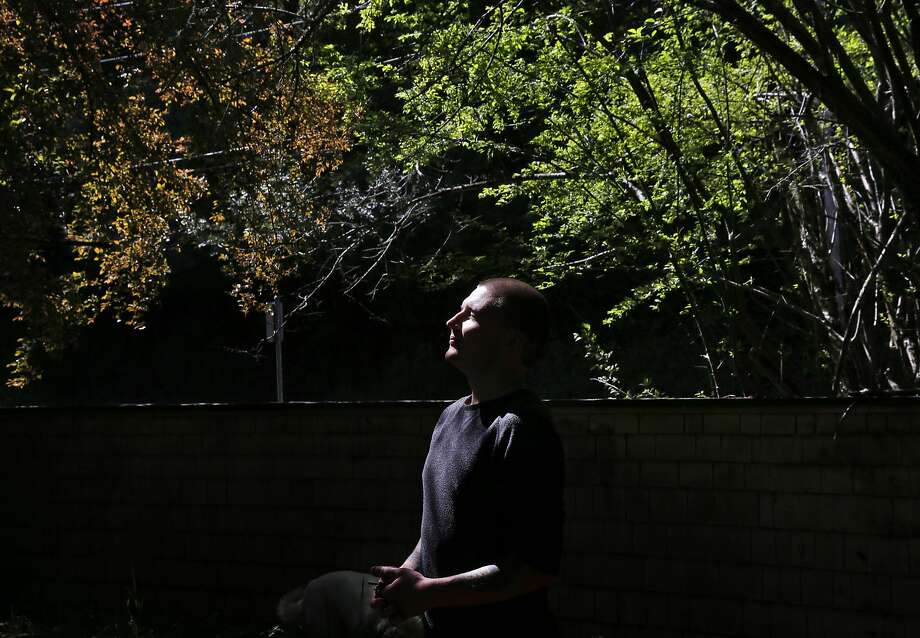 Denis Flynn stands outside his childhood home in Los Gatos. He has moved out after suing his adoptive parents for abuse. Photo: Leah Millis, The Chronicle