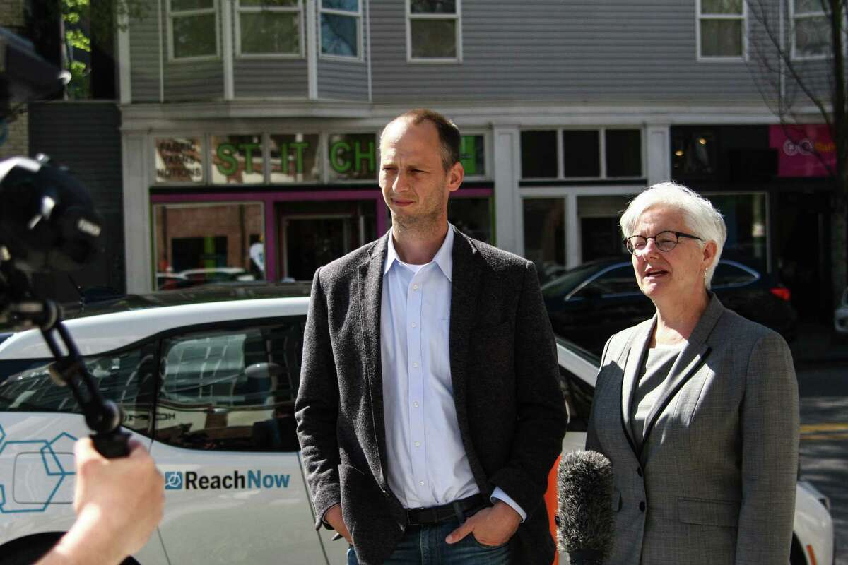 Seattle Department of Transportation Director Scott Kubly and Deputy Mayor Kate Joncas discuss the launch of BMW's ReachNow car-sharing service in Seattle after a press event Friday, April 8, 2016.
