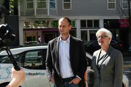Seattle Department of Transportation Director Scott Kubly and Deputy Mayor Kate Joncas discuss the launch of BMW's ReachNow car-sharing service in Seattle after a press event Friday, April 8, 2016. DANIEL DEMAY/SEATTLEPI.COM