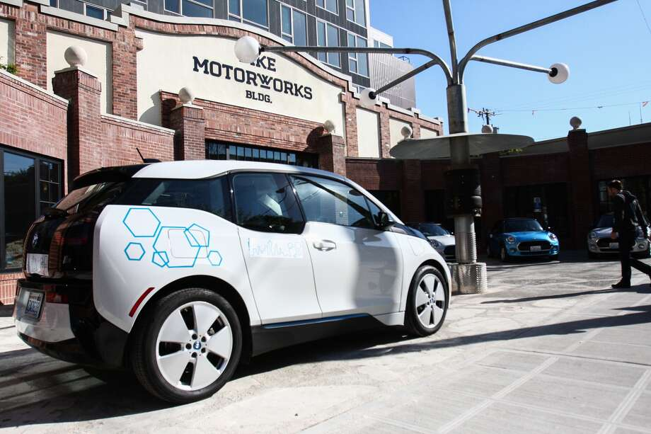 One of the BMW i3 electric cars that is available with the ReachNow car-sharing service is seen outside the Pike Motorworks building before a press event Friday announcing the new service in Seattle. DANIEL DEMAY/SEATTLEPI.COM Photo: DANIEL DEMAY/SEATTLEPI.COM