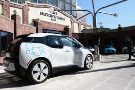 One of the BMW i3 electric cars that is available with the ReachNow car-sharing service is seen outside the Pike Motorworks building before a press event Friday announcing the new service in Seattle. DANIEL DEMAY/SEATTLEPI.COM