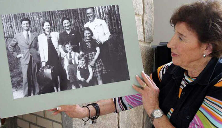 Anita Schorr, in a 2011 photo, holds a picture of her family and another family taken in the spring of 1941. A few weeks later, Schorr and her family would be deported from their home Czech city of Brno to the town of Terezin, which German forces ran as a Jewish ghetto during World War II. They later were dispatched to concentration camps. Photo: Westport News / File Photo / Westport News