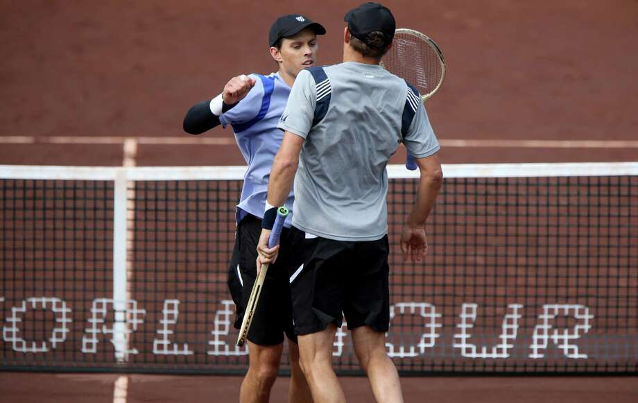 Mike Bryan and twin brother Bob Bryan chest bump after defeating Steve Johnson and Sam Querrey, 7-6(5), 6-3, in a doubles match during the U.S. Men's Clay Court Championships at River Oaks Country Club, Friday, April 8, 2016, in Houston, Texas. Photo: Gary Coronado, Houston Chronicle / © 2015 Houston Chronicle